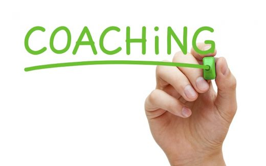 Hand writing Coaching with green marker on transparent wipe board.